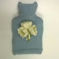 Knitted hot water bottle cover with autumn crocus