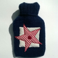 Knitted navy blue hot water bottle cover with gingham star