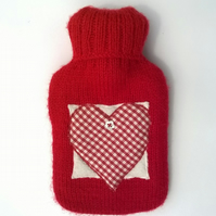 Knitted red hot water bottle with gingham heart