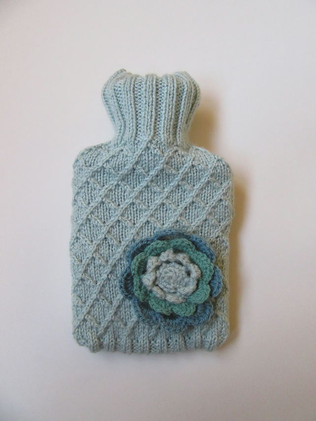 Duck egg blue trellis stitch hot water bottle cover with crocheted flower