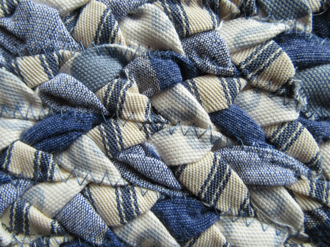 Hand braided blue oval rug