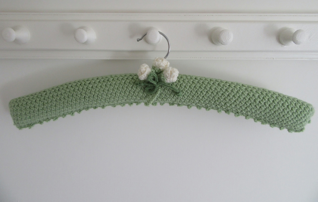 Ladies coat hanger hand knitted using lace stitch with cream buds