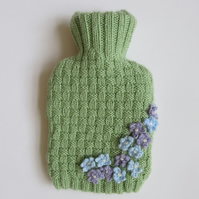 Knitted ditsy flowers hot water bottle cover