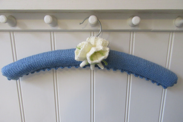 Knitted coat hanger with  a posy of white crocus