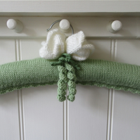 Hand knitted ladies coat hanger with white tulips