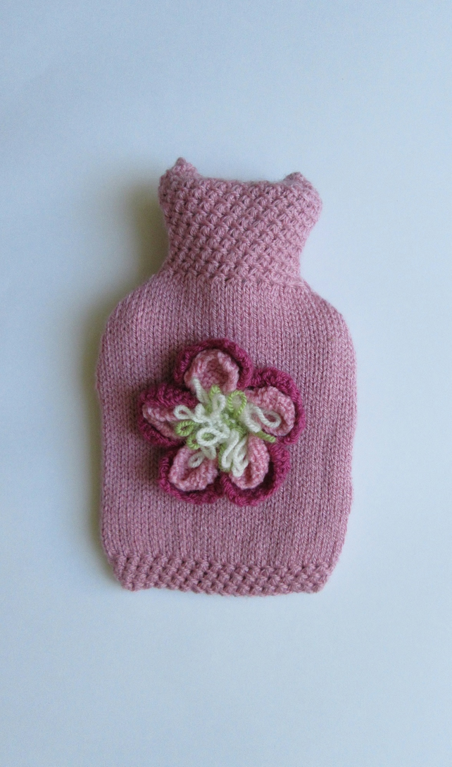 Hand knitted pink peony hot water bottle cover