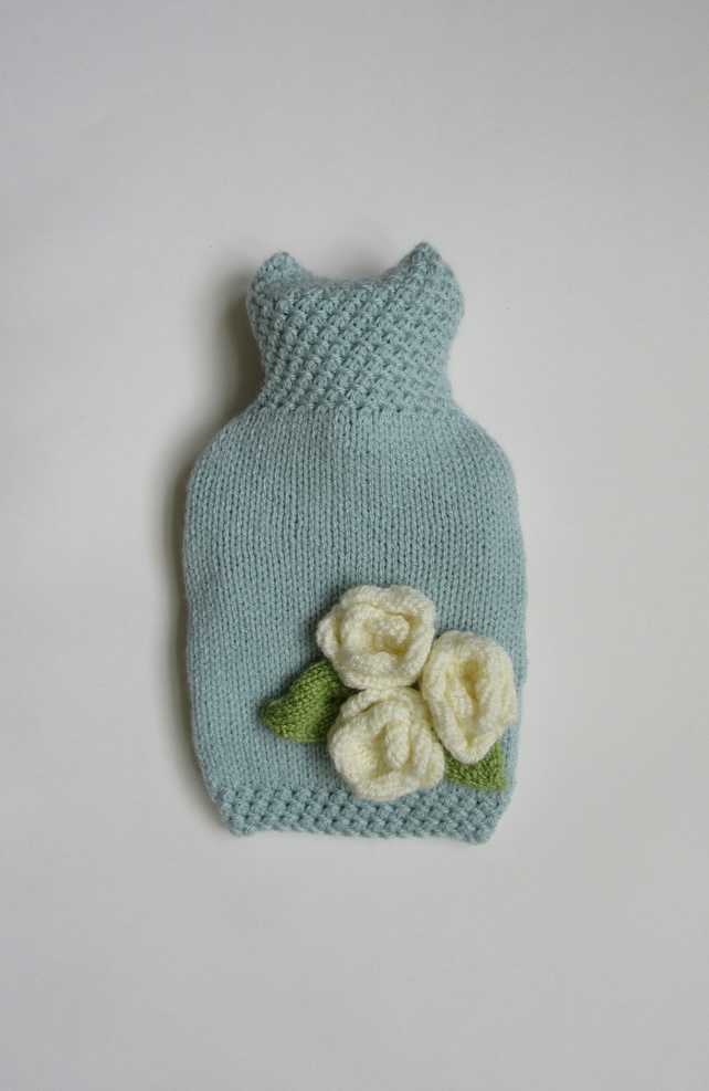 Duck egg blue hot water bottle cover with three cream roses.