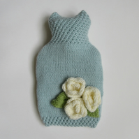 Duck egg blue hot water bottle cover with 3 cream roses.