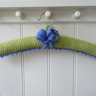 Padded ladies coat hanger with hand knitted crocus flowers