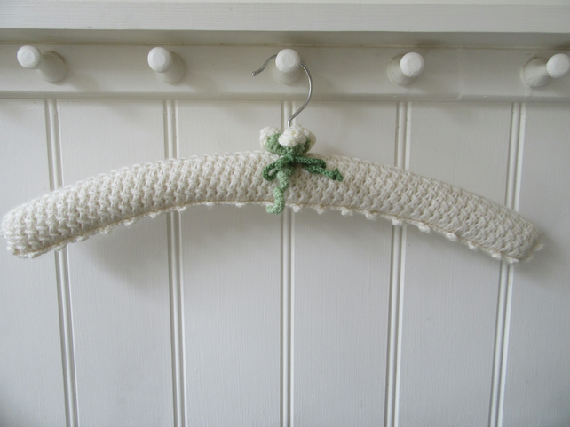 Padded coat hanger for bridal gown