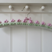 Knitted coat hanger in cream with sorbet pink bobble bud flowers