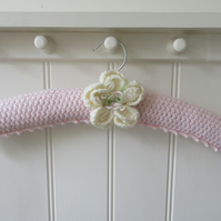 Knitted padded ladies palest rose pink coat hanger with large peony flower