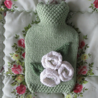 Hand knitted soft green hot water bottle cover with cream roses