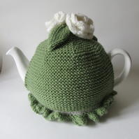 Hand knitted meadow green tea pot cosie with cream roses