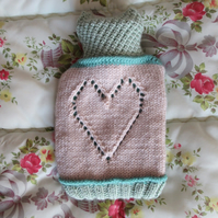 Hand knitted lace heart hot water bottle cover - pale green