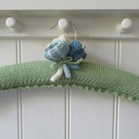 Knitted ladies padded coat hanger - meadow green with crocus flowers