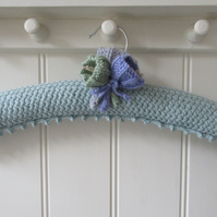 Hand knitted duck egg blue ladies coat hanger with crocus flowers