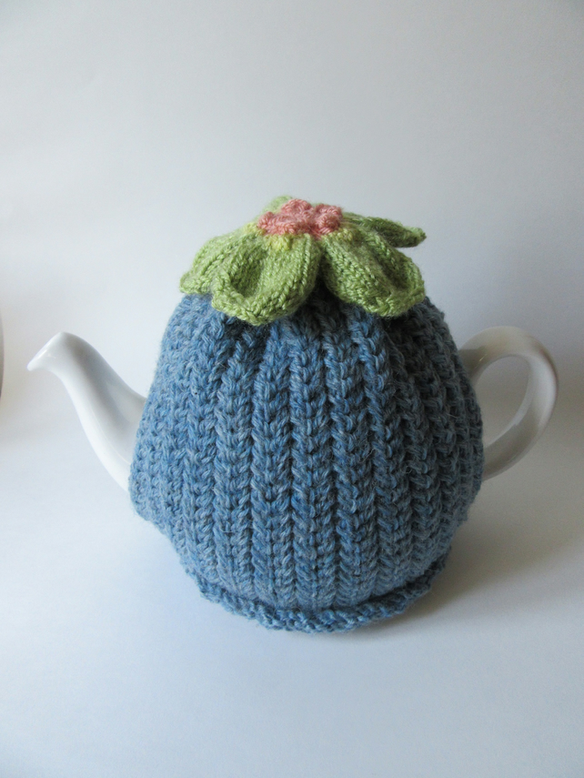 Knitted denim tea pot cosie with anemone flower