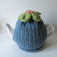 Knitted denim blue tea pot cosie with anemone flower