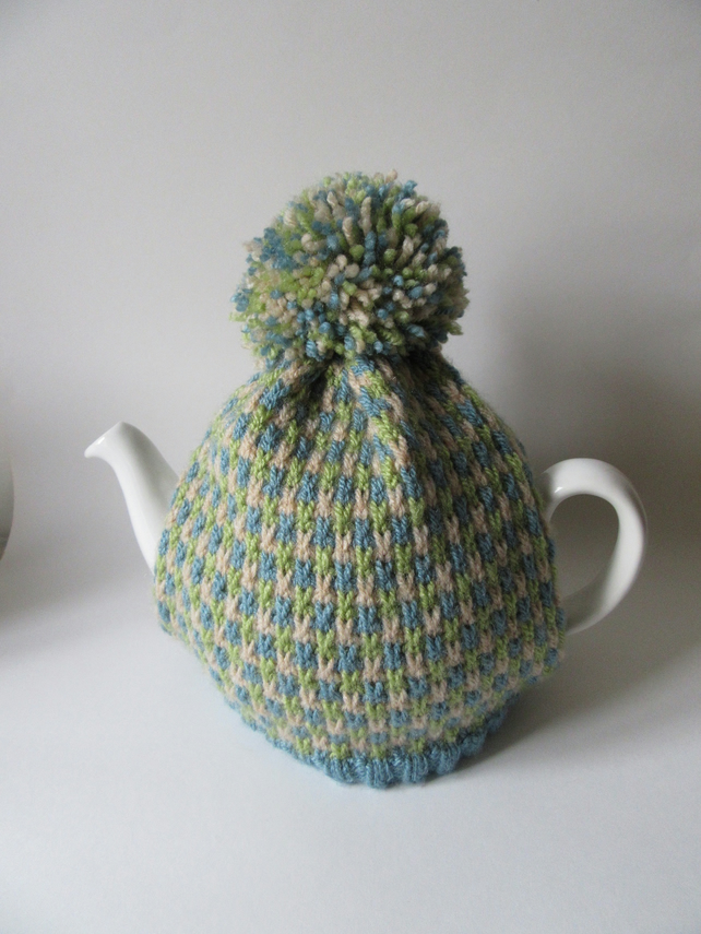 Knitted summer tweed tea pot cosie with oversized pompom