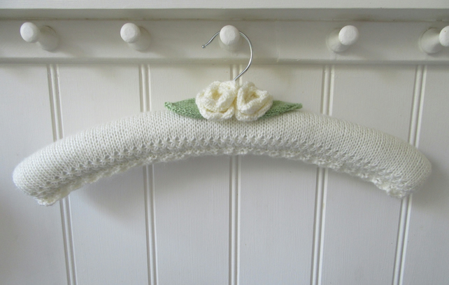 Hand knitted padded coat hanger for a wedding dress