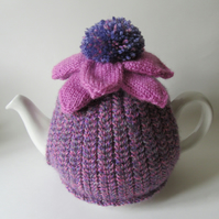 Hand knitted tea cosie with echinacea flower