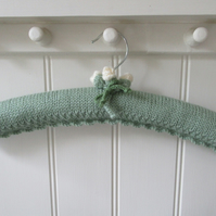 Ladies padded green coat hanger with rose buds