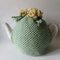Hand knitted green tea pot cosie with daffodils
