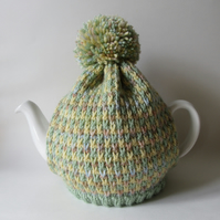 Knitted spring tweed tea pot cosie with oversized pompom