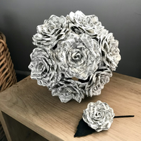 Bouquet of paper flowers made from vintage music sheet