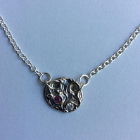 Sterling silver disc pendant with ruby