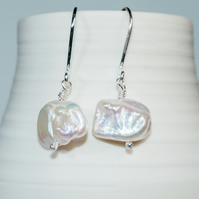 Naturally luminous freshwater pearl earrings on handmade ecosilver earwires