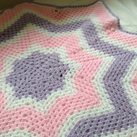 Hand crocheted granny star blanket