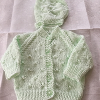 Hand knitted baby cardigan and matching bonnet - newborn size