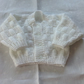 Hand knitted baby cardigan - newborn size