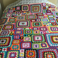 Crochet extra large bright coloured granny square bed or sofa throw