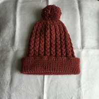 Hand knitted ladies cable effect Pom Pom hat - rust