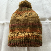 Hand knitted ladies Pom Pom hat in autumn colours