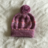 Hand knitted striped ladies Pom Pom hat in pinks and lilac