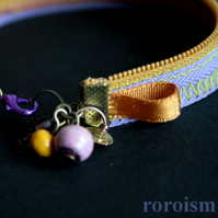 Lilac and Ocher ZIPPER BRACELET with zic zac stitch, charms and beads