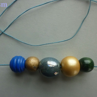 Trendy TEAL and GOLD ceremic, wood and string necklace