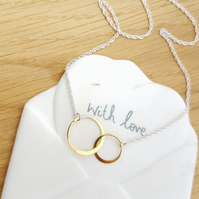 Gold Interlocking Double Circle Ring Pendant on a Sterling Silver Chain Necklace