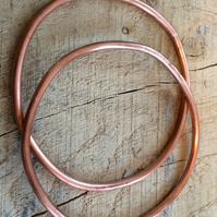 Two solid copper bangles