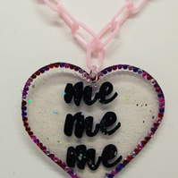 hand drawn shrink plastic heart charm necklace with pink crystals and glitter.
