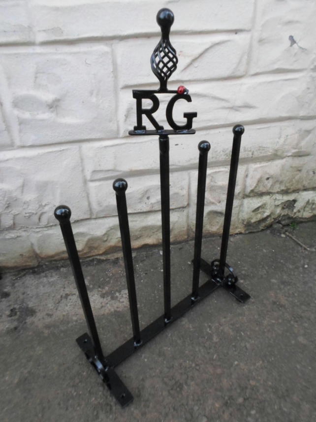 "WROUGHT IRON ""LADYBIRD"" INITIALLED WELLIE STAND"
