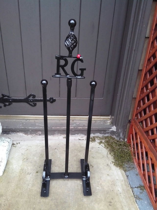 "WROUGHT IRON ""LADYBIRD"" WELLIE STAND"
