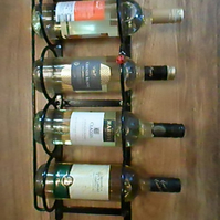 "WROUGHT IRON  4 BOTTLE ""LADYBIRD"" WINE RACK"