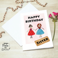 Happy Birthday Sister card with two rag dolls illustration.