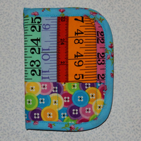 Needlecase - Bright tape measures and buttons