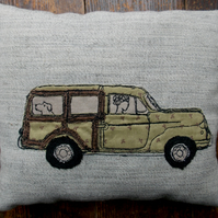 Sybil takes Agatha out for a spin - free motion embroidered cushion.